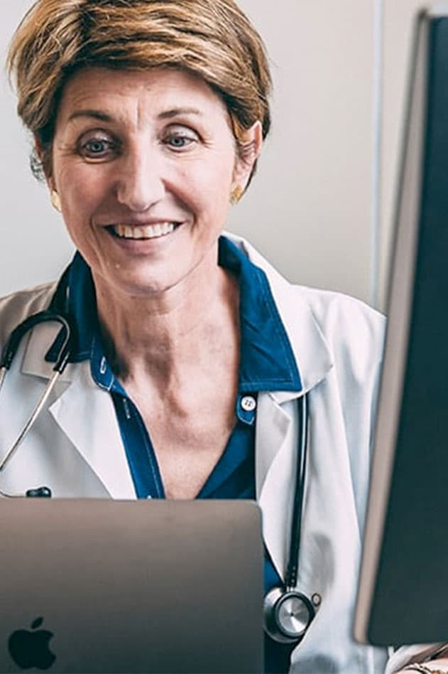 physician behind computer